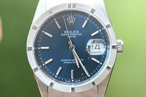 Rolex Mens Stainless Steel Date Blue Engine Turned Bezel Oyster Band 34mm 15210