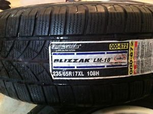 Set of 4 Granite Alloy Wheels and Bridgestone Blizzak Snow Tires 235 65R17