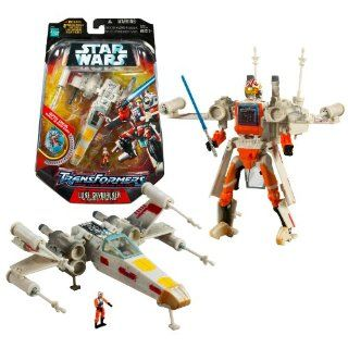 Hasbro Year 2007 Star Wars Transformers Series 7 Inch Tall Action Figure   LUKE SKYWALKER X WING FIGHTER with Blue Lightsaber, 4 Missile Launchers, 4 Missiles and Luke Skywalker Pilot Mini Figure Electronics